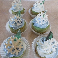Frozen Cupcakes   White Cake, Vanilla Buttercream. White Chocolate snowflakes. Candy Ice. 8 year old's birthday.