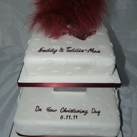 Burgundy Feather Christening Cake Two tier Christening cake for a brother and sister.