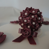 Ivory And Burgundy Wedding Cake 3 tiers of wedding cake in colour and design to complement bridal gown. The flower ball topper is flowerpaste.The tiers were assembled at...