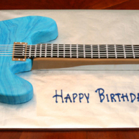 Electric Guitar Full size guitar cake. Used two colors of fondant, twisted together and rolled out to achieve marbleing effect.