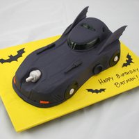 Batmobile My first sculpted cake. I used two layers of sheet cake and sculpted the basic car shape. I added the roof as a separate piece of cake...