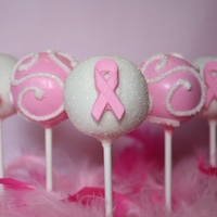 Pink And White Cake Pops With Breast Cancer Awareness Ribbon Ribbon Was Made With Chocolate And A Mold Pink and white cake pops with breast cancer awareness ribbon. Ribbon was made with chocolate and a mold.