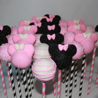 Pink Minnie Mouse Cake Pops On Paper Straws Pink Minnie Mouse cake pops on paper straws.
