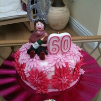 60Th Birthday   sponge cake filled with raspberries and coconut creamfondant figure all edible