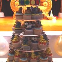 Zoo Animal Baby Shower Baby Shower Cupcakes Tower. Each cupcake is topped with a sugar paste zoo animal. Top cake has baby in blocks across the front with a palm...