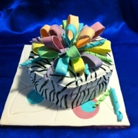 Zebra Box Zebra print gift box topped with brightly colored bow.