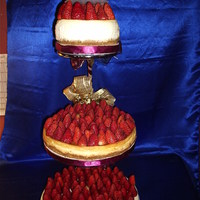 Cheesecake Wedding Cake This is a 3 tier cheesecake topped with fresh strawberries. The bride and groom on top are chocolate covered strawberries.