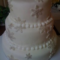 Snowflake Winter Wedding 3 tier white cake covered with MMF, accented with MMF snowflakes painted silver to match bride's wedding.