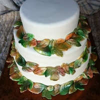Fall Wedding Cake Ivory fondant with hand made and painted leaves
