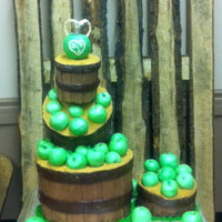 Apple Barrel Wedding Cake The stacked barrels are styrofoam covered in fondant. The small barrel is a vanilla butter cake that the bride and groom cut. The apples...