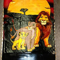 Hand Painted Lion King Cake Hand painted on fondant which was then applied to the cake. Too bad I only have this cell phone foto.