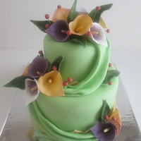 Cally Lily Cake With Fabric Drapes   All fondant with gum paste flowers.