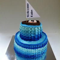 Nautical Baby Shower Cake   Buttercream icing. First time using the petal technique. Not perfect but I learned a lot :). Baby and boat are gum paste
