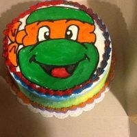 Mikey Ninja Turtle Cake Hand Drawn Mikey Airbrushed Sides Two Toned Border Cake Is A Layer Of Blue Velvet Cake And A Layer Of Oran  Mikey Ninja Turtle Cake..... Hand drawn Mikey, airbrushed sides, two-toned border... Cake is a layer of Blue Velvet cake and a layer of...
