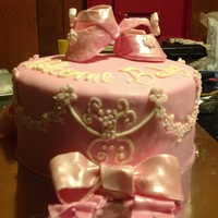 Pretty N Pink For My Baby Girl Baby shower pink cake. Wth booties and bow.