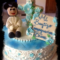 "Baby Mickey Baptism Cake 12"" Tres Leches Vanilla Cake with filled with Fresh Strawberries. Covered in whipped cream, decorations all edible made of Modeling..."