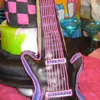 Electric Guitar Done for yet another grandchild :) I used birthday candles for the tuning keys She loved it