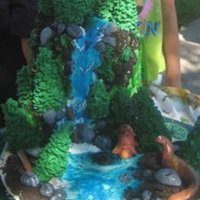 "Prehistoric Lake My granddaughter wanted a ""mountain forest"" cake my grandson wanted a ""dinosaur"" cake, since they share a birthday we..."