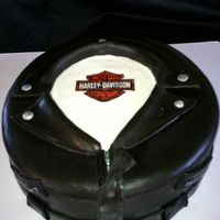 Harley Grooms Cake Flourless chocolate cake and white chocolate ganache. The design is not mine the bride brought me a pic of one similar. All fondant and...