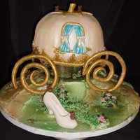 Cinderella's Coach The coach is chocolate cake w/ chocolate ganache the ground is white cake/ cream cheese frosting. The coach is covered in fondant, ground...