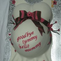 Baby Shower Belly Cake cake for a baby shower. cake is vanilla cake with strawberries and whipped cream. covered in MMF