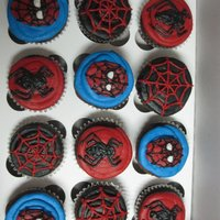 Spiderman Cupcakes   done for my friend's little brother's birthday. vanilla cupcakes with vanilla buttercream designs.