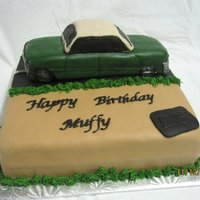 Car Cake  This cake was done for a friend's husaband who restores old cars. I made the car entirely out of gumpaste and it took forever to get...