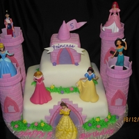 Princess Castle  This was done for a friend of a friend. The cake is covered in fondant and the columns are rice crispies treats covered in fondant... the...