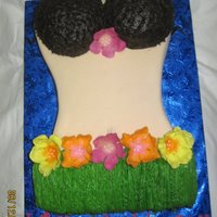 Hawaiian Torso  This cake was for a woman's 60th birthday. Cake was french vanilla with cream cheese filling. covered in fondant then the grass skirt...