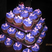 Butterfly Cupcakes This was for a friend's birthday at a club, she wanted something simple for people to eat. Chocolate cupcakes with vanilla buttercream...