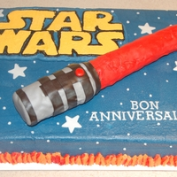 Star Wars  sheet cake has fondant accents, made a BC transfer for Star Wars name. Light saber is made out of RKT and covered in fondant, was for a...