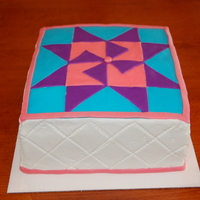 Quilting Time   8 in cake covered in buttercream, the quilt square is made from fondant. The sides quilting lines were made using the rolling tool.