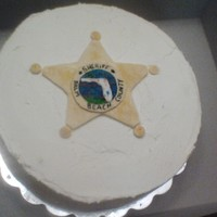 Sheriff's Badge Cake Cinnamon Roll cake with vanilla/almond butter cream. Badge is MMF hand painted. TFL!