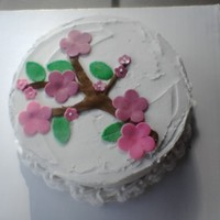 Flower Cake Hazelnut creme brulee cake with hazelnut liquor butter cream icing. MMF accents. Thanks for looking!