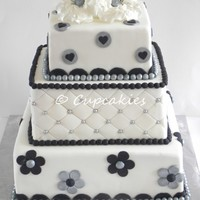 Black And White Wedding Don't like to make square cake's... i'm not really good in covering square cakes... but after all I liked this one...