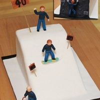 Down From Now On.... Cake for a guy who loves climbing and snowboarding.