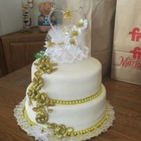 50Th Wedding Annv. Cake *White fondant covered cakes, gold colored chocolate candy trim and home made gold airbrushed roses cascading down the side. The topper was...