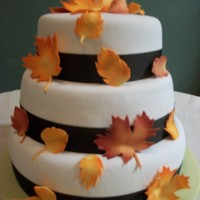Autumn Leaves gumpaste autumn leaves, white fondant and a brown ribbon around the base of each tier.