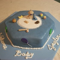 Baby On Carpet Made baby and toys out of gumpaste. rolled out white fondant and used BC icing around the cirle to look like a rug. I think it looks like a...