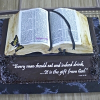 Well-Read Bible Open Bible with gum paste butterfly. Two tier, four layer cake. Printed icing sheets for the extra touch of realism.