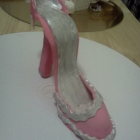 Gumpaste Shoe  My first attempt at a gumpaste high heeled shoe. There's a lot of things I'll do next time around. But I'm happy with the...