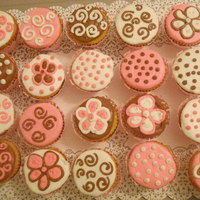 Pink, White & Chocolate Cupcakes Yellow cake cupcakes with pink, white & chocolate buttercream. The various designs were picked out by the customer for a baby shower....