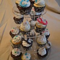 Nursing School Cupcake Tower I made these to match the nursing school graduation cake. WASC & chocolate cupcakes with BC. Figures are modeling chocolate except for...