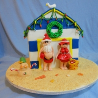 Santa's Beach House This cake is modeled after a Debbie Brown cake. It's for a silent auction for my son's school. Living near the beach I thought...