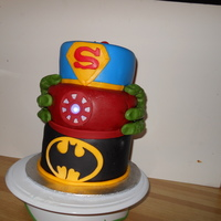 Batman, Iron Man, Superman And Incredible Hulk baby shower cake for coworker. iron man lights up