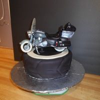 Motorcycle Harley Davison replica bike of owners, cake decorated like white wall tire. bike combo fondant and modeling chocolate, isolmalt for windshield.