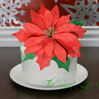 Eggnog Cake With Textured Buttercream And A Very Large Gum Paste Poinsettia Eggnog cake with textured buttercream and a very large gum paste poinsettia
