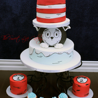 Cat In The Hat/dr. Seuss Cake 3 tiered cat in hat cake (bottom is yellow cake with buttercream and middle and top tiers are chocolate cake with buttercream) covered in...
