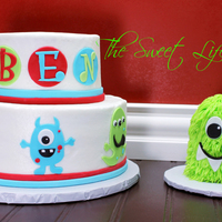 Monster Birthday Cake Made To Match Invitation With Matching Smash Cake Yellow Cake And Chocolate Cake Covered In Bc With Fondant Accents Monster birthday cake made to match invitation with matching smash cake. Yellow cake and chocolate cake covered in BC with fondant accents...