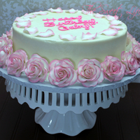 Strawberry Cake Covered In Bc With Gum Paste Roses And Rose Petals Customer Asked For A Cake Just Like Selena Gomezs Rose Cake Strawberry cake covered in BC with gum paste roses and rose petals. Customer asked for a cake just like Selena Gomez's rose cake.